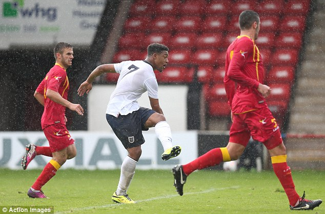 Ibe fires home England's first goal in their 6-0 win over Montenegro in a European Championship qualifier