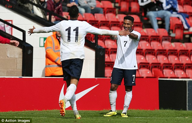 Hat-trick hero: Ibe celebrates the third of his three goals as England started their Elite Round qualifiers for the European Championships in style at Walsall