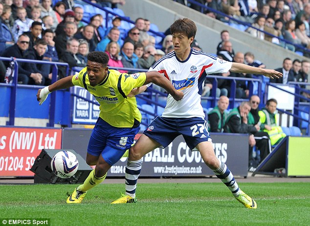Obstruction: Ibe tries to get around Bolton's Lee Chung-Yong on the final day of the season