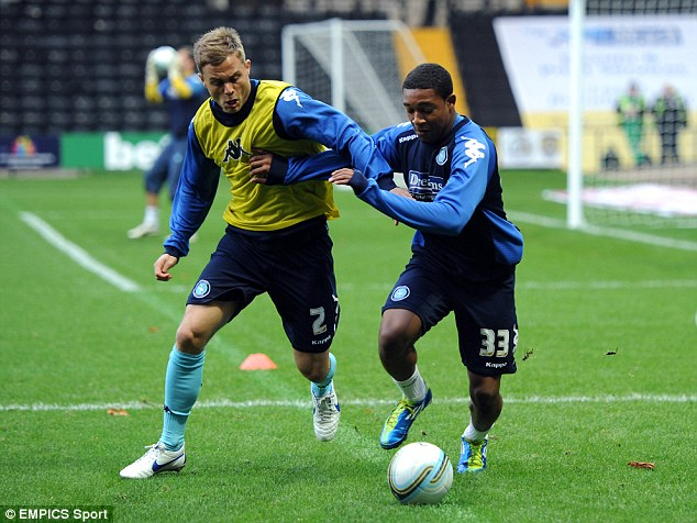 Ibe (right) started out at Wycombe and was the club's youngest Football League debutant and goalscorer
