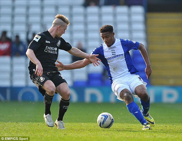 One-on-one: Ibe takes on Bournemouth's Matt Ritchie during one of his loan appearances at Birmingham