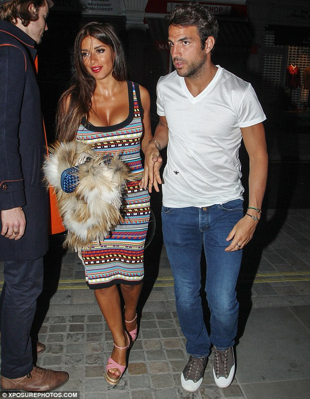 Hand-in-hand: Cesc Fabregas and his girlfriend Daniella Semaan headed out for a romantic evening in London on Sunday night