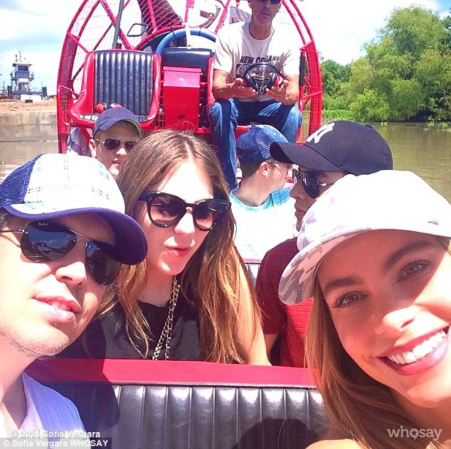 Boat tour: Sofia posed with her son Manolo as they took a ride through the bayou