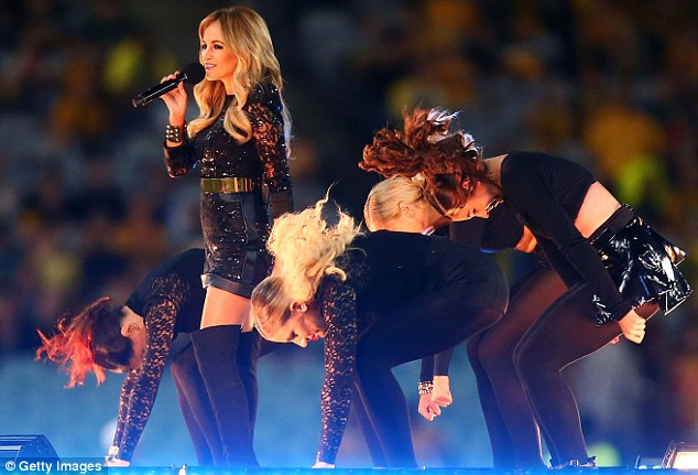 Belting it out: The X Factor Australia winner was surrounded by back-up dancers as she performed for the crowd at ANZ Stadium