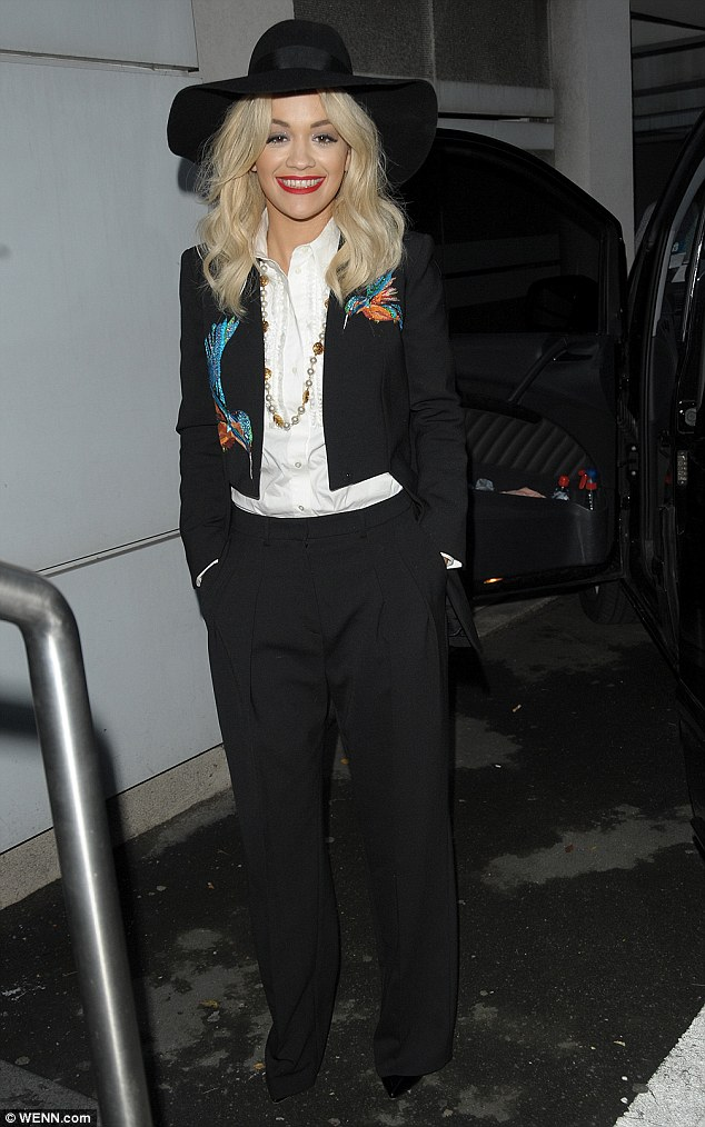 Hat off to her! Rita Ora looked very stylish in her dramatic suit ensemble