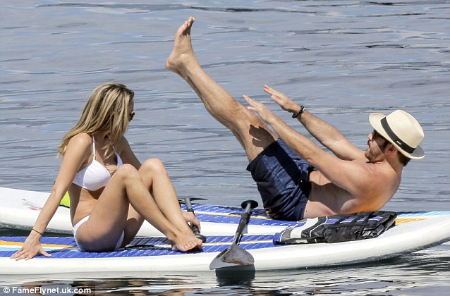 Pilates prowess: The actor looked like he was practicing some ab-enhancing Pilates moves on his paddle board