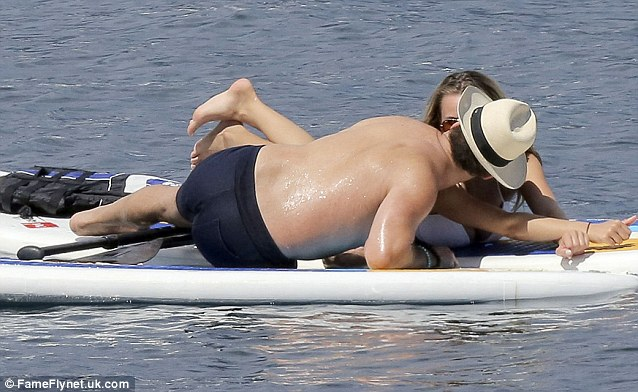 Close up: Jeremy and his date were spotted maneuvering a paddle board kiss at sea