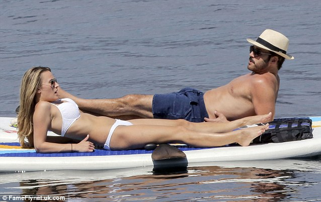 Sea legs: The couple looked relaxed around each other as they stretched out on their paddle boards