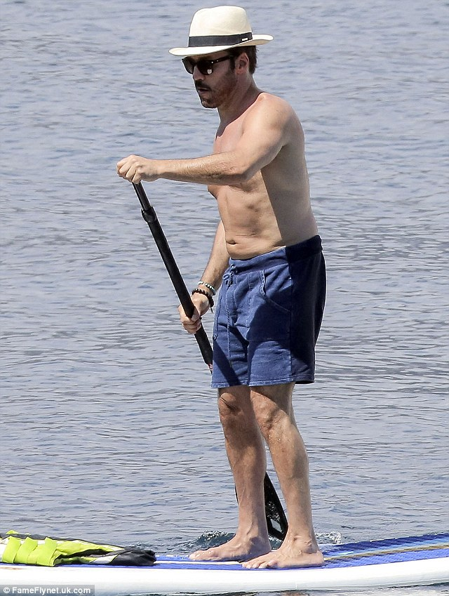 Riveria cool: Jeremy went for a nautical look in his navy shorts and striped trilby