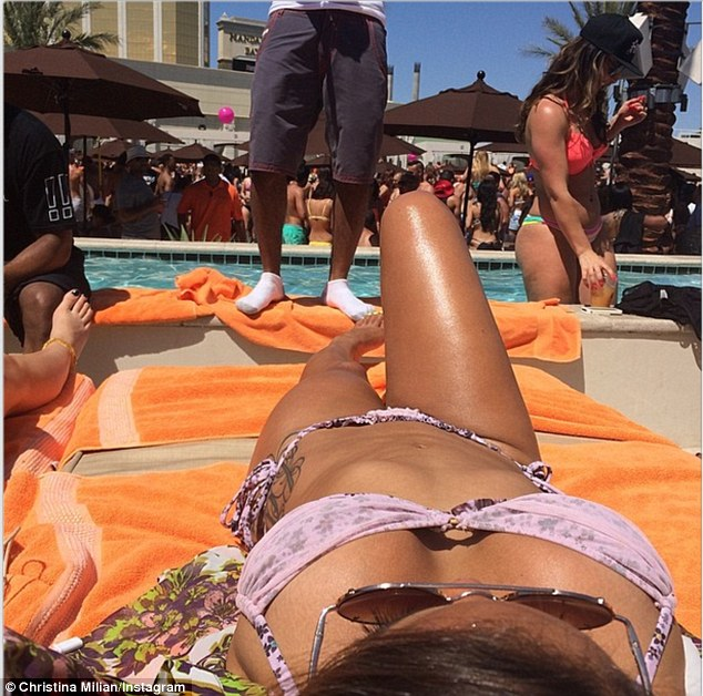 Lounging: The Voice's social correspondent appeared to be having a blast at the crowded pool party where she was joined by a large entourage of friends
