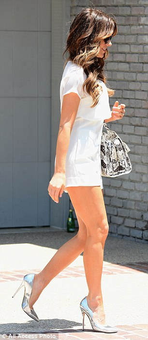Simply stunning: For the party, the Total Recall star went for a striking all-white look of a romper with short shorts - which showed off her toned and tanned legs - which featured a white sheer chiffon layer over the top