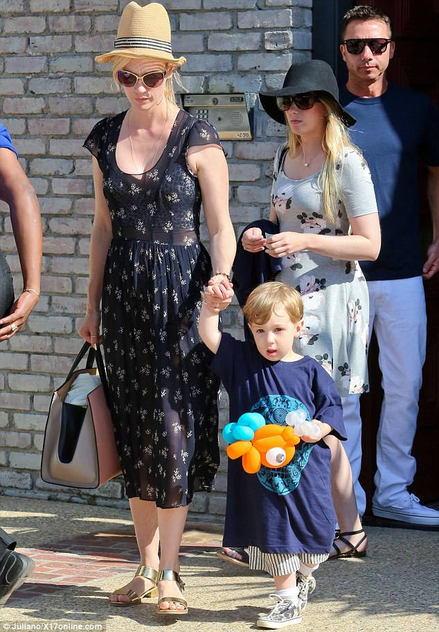 Party goodies: January Jones' son Xander left the event with a balloon animal