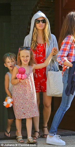 Star power: Another famous family to get amongst the beachside fun was Tobey Maguire, his wife Jennifer Meyer and children Otis and Ruby