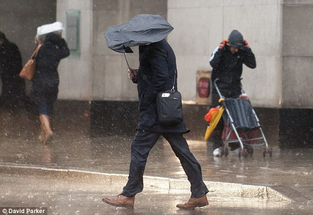 Damp squib: Retailers reported an 8.9 per cent decline in footfall over the wet bank holiday weeekend