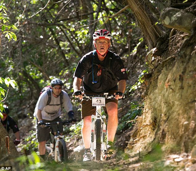 Road to recovery: Former Preisdent George W. Bush has undergone a partial knee replacement and the trouble arose in spite of his active retirement lifestyle (which includes bike races, like this one on May 2)