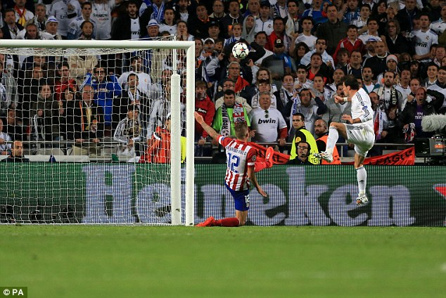 Rising high: Alonso charge is in relation to Gareth Bale's (right) extra time Champions League final header