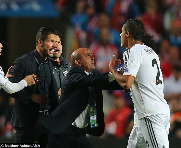 Feisty: Diego Simeone has been charged by UEFA after confronting Raphael Varane on Saturday