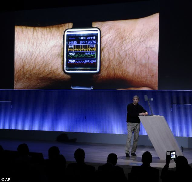 Last night, Samsung revealed a new smart wristband and announced plans to let manufacturers use the same core components - much like the mobile phone market. Ram Fish, Vice President of Digital Health for Samsung is pictured displaying the Simband