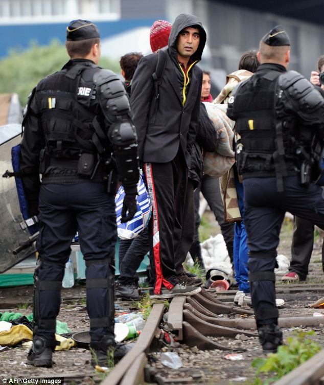 There was little resistance as the armed officers wearing body armour and carrying plastic shields moved in shortly after 8am, but as the clear-outs continued, there were scuffles between police and a few dozen activists demonstrating against the rough treatment of the migrants