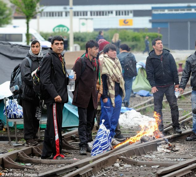 Illegal immigrants wait to be expelled from the camp