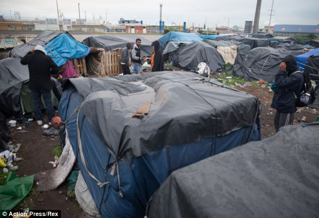 The migrants play a nightly game of cat and mouse with the police and border officials as they try to reach Britain in the back of lorries