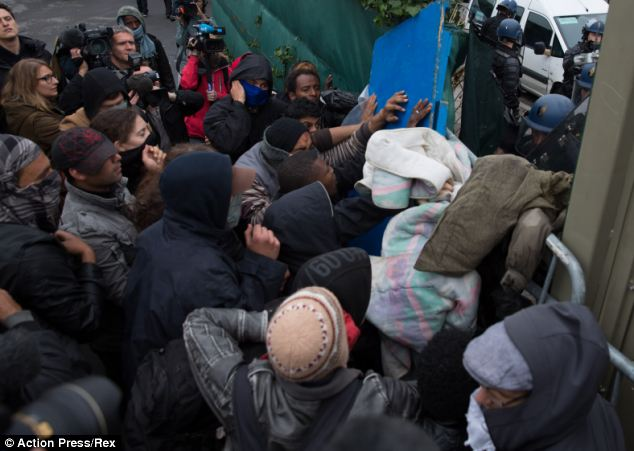 Squads of French riot police today smashed up and then bulldozed three illegal camps full of UK-bound migrants in Calais