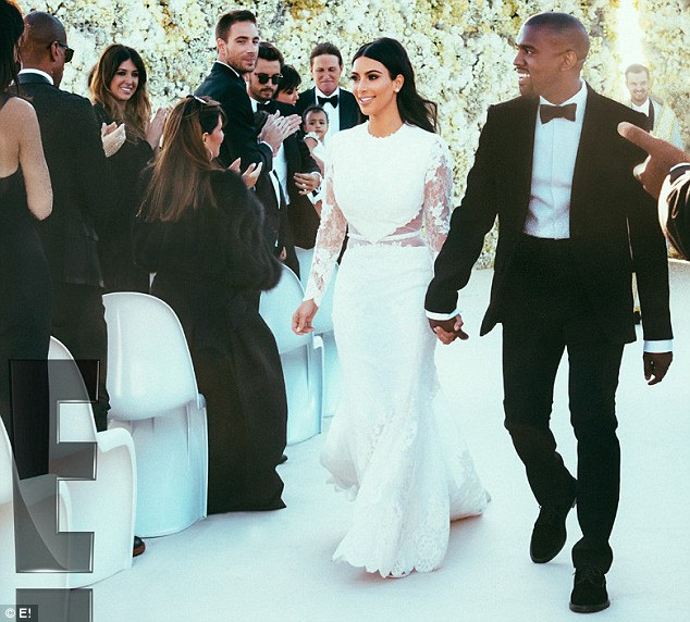 Just married! A flawless looking Kim and her rapper husband Kanye beamed with happiness as they walked hand-in-hand down the aisle after getting married at their lavish wedding in Florence, Italy