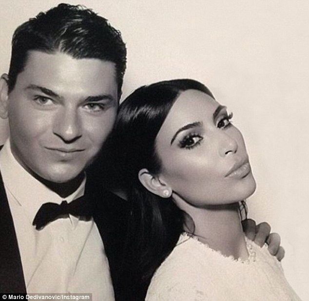 Flawless: Celebrity make-up artist Mario Dedivanovic revealed he was the man behind Kim Kardashian's flawless face for her Florence wedding on Saturday. He shared this snap on his Instagram of the pair pouting in Kim and Kanye's wedding photo-booth.