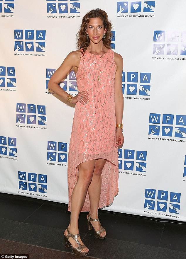 Shimmering: Alysia wore a sparkling pink dress with gold pumps at the event