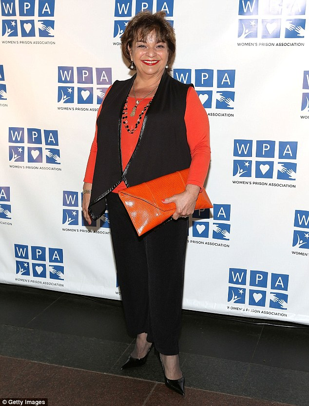 Vibrant: Lin Tucci - who portrayed Anita DeMarco on OITNB - colour-coordinated her red-orange top with a matching clutch