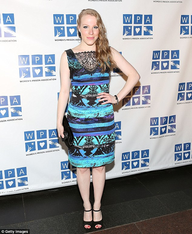 I'm blue: Emma Myles wore a lacy blue patterned dress with black peep toe heels