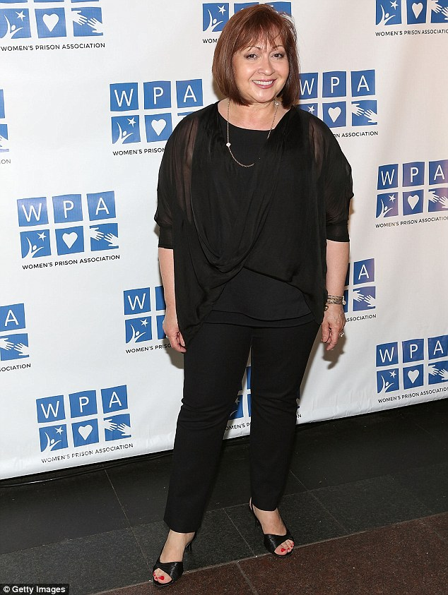A pop of colour! Tamara Torres - who played the Weeping Woman in OITNB - smiled in a billowing black top and matching trousers