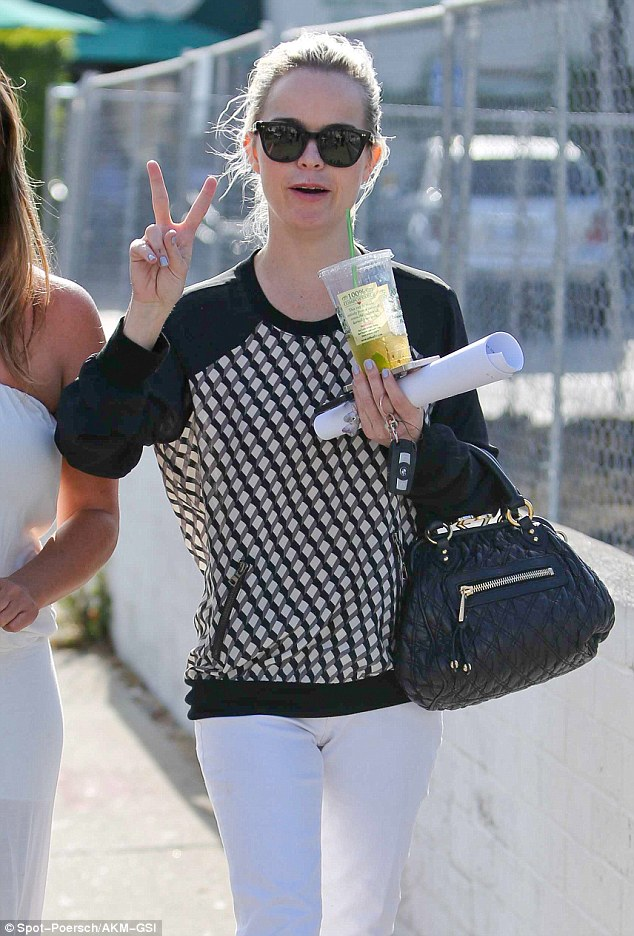 Peace! Taryn Manning flashed a peace sign while strolling through West Hollywood on Tuesday