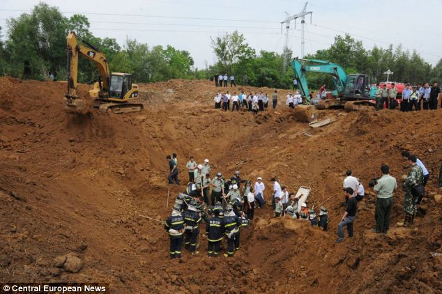 The firemen gave their lives trying to rescue Zhuo Jinbo, 46, a construction worker who was entombed beneath thousands of tons of earth