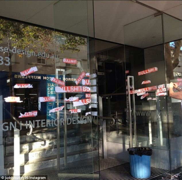 Vandals covered the front door and windows of the Whitehouse Institute Surry Hills campus on Tuesday, with stickers that simply said 'Bulls***' in response to Frances Abbott's $60,000 scholarship at the design college