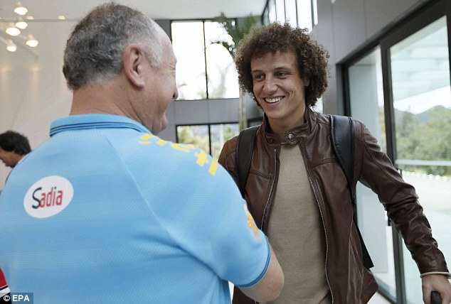 All smiles: PSG are ready to shell out £50m on Chelsea defender David Luiz, who has joined up with Brazil
