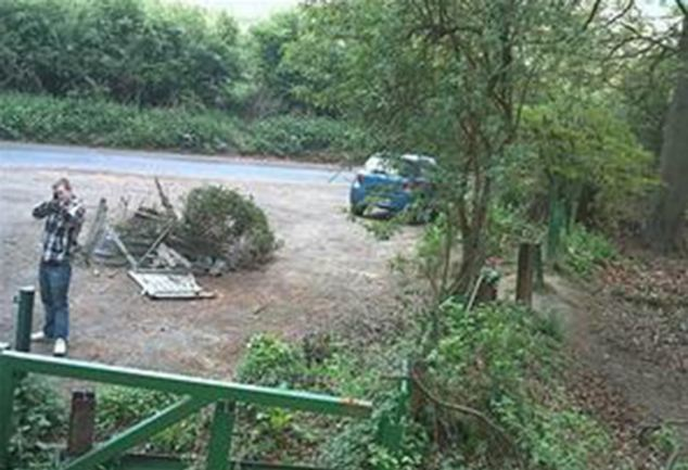 Police want to speak to a man seen taking aim at CCTV cameras installed at a notorious fly-tipping hotspot