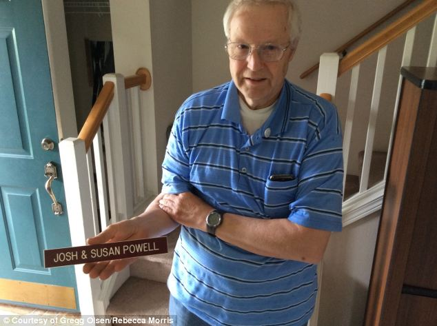 Missed: Cox holds a sign previously belonging to his missing daughter and her husband, Josh, who died in 2012