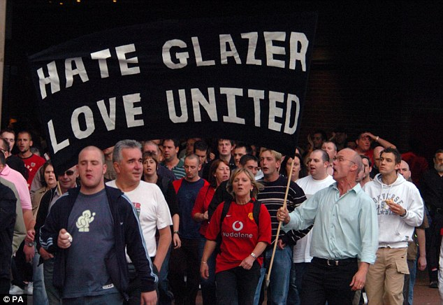 Manchester United fans protesting the takeover of the club by entrepreneur Malcolm Glazer