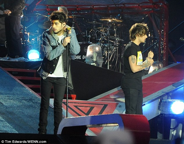 Bandmembers Zayn Malik and Louis Tomlinson last night as they joined the rest of the group for a gig in Sunderland, but parents outside admitted their clean-cut image was now tarnished