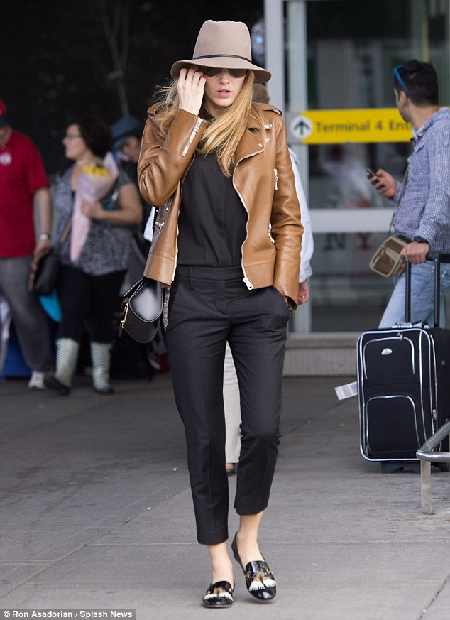 Airport chic: On May 19 Blake showed her stylish side in a black jumper with a light brown Gucci leather jacket, black Christian Louboutin flats, a Givenchy purse, and brown fedora hat
