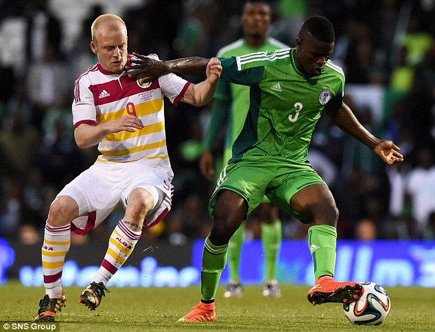 Tussle: Nigeria's Elderson Echiejile keeps Steven Naismith at arms length