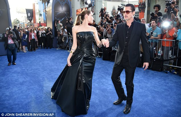 Gorgeous at every angle: Angelina twirled so as to show off all the sides of her stunning dress