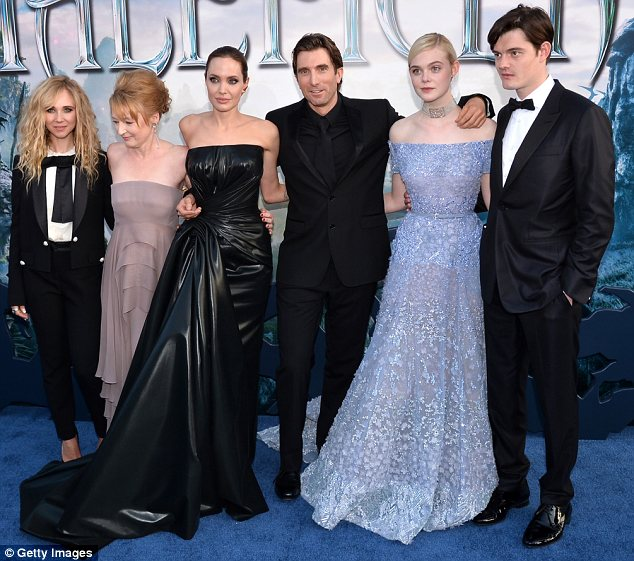 Let's get together: (L-R) Juno Temple, Lesley Manville, Angelina, Sharlto Copley, Elle and Sam Riley posed on the red carpet