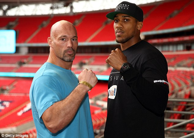 Power struggle: Anthony Joshua will look to extend his unbeaten record against Matt Legg at Wembley