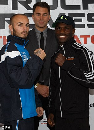 Kevin Mitchell, (left)  with his opponent Ghislain Maduma
