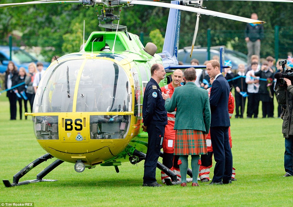 New job? Prince William was fascinated by the helicopter owned by the Scottish Air Ambulance and may soon be flying one of the aircraft himself