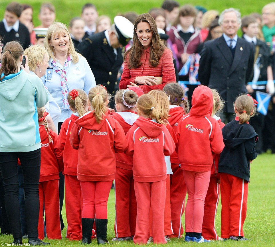 Meet and greet: This group of little girls appeared delighted to meet the Duchess - who seemed just as thrilled to meet them during her visit to a Scottish school