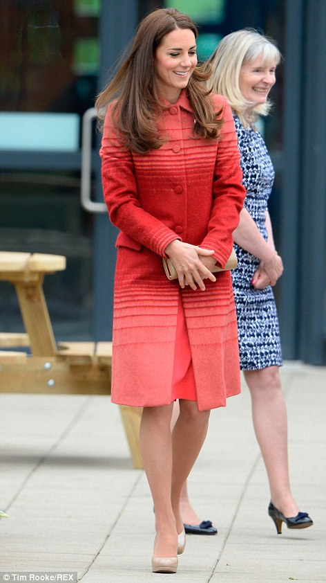 Kate chose an unusual red coat for the visit, paired with a nude handbag and heels