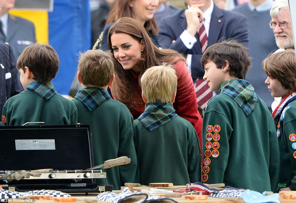 Looking good: The Duchess of Cambridge beamed as she greeted children during a visit to Scotland